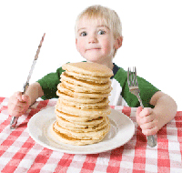 kid eating pancakes